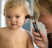 a woman checking a baby's hearing