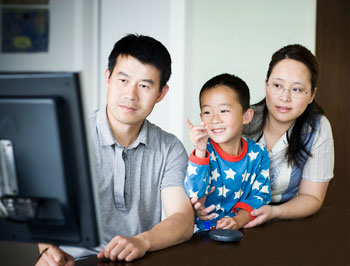 a young family viewing a website